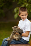 Funny boy with cat Royalty Free Stock Image