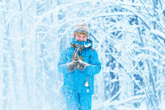 Funny boy caught in a snow storm Stock Photo