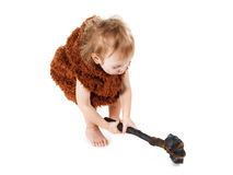 Funny boy caveman in a suit with dirty face holding an ax. Royalty Free Stock Image