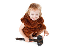 Funny boy caveman in a suit with dirty face holding an ax. Little funny caveman boy in a suit with a dirty face holding an ax. Humorous concept ancient caveman royalty free stock photo