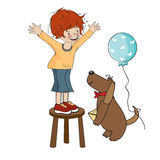 Funny boy celebrates his birthday with dog Stock Photography