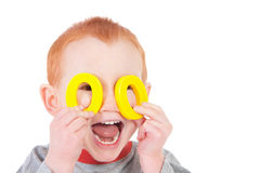 Funny boy child hiding behind mask Stock Photos