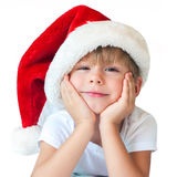Funny Boy in Christmas Santa Hat Isolated White. Funny Boy in Christmas Santa Hat with Smile on Face Christmas theme Isolated White Stock Image