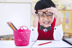 Funny boy in classroom Royalty Free Stock Image