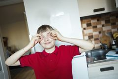 Funny boy close eyes with candy like glasses stock image