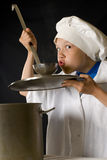 Funny boy-cook. Tasting of a dish Royalty Free Stock Photo