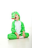 Funny boy in crocodile oufit Stock Image