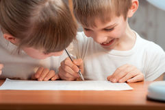 Funny boy draws a pen on paper Royalty Free Stock Photo