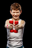 Funny boy with dumbbells Royalty Free Stock Image
