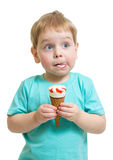 Funny boy eating icecream isolated Royalty Free Stock Images