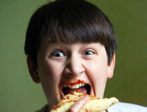 Funny Boy Eating Pizza Stock Photos