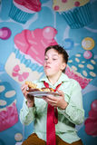 Funny boy eating sweet cakes, hungry and candy man Royalty Free Stock Photography