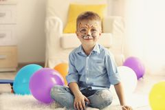Funny boy with face painting in room. Funny boy with face painting in his room stock photos