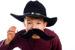 Funny boy with fake mustache disguise Royalty Free Stock Photos