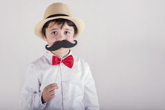 Funny boy with fake mustache Royalty Free Stock Photography