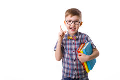 Funny boy five years with books on a white background Royalty Free Stock Images