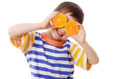 Funny boy with fruits on eyes Stock Photo