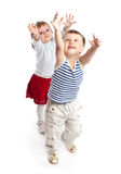 Funny boy and girl is playing in the studio Stock Images
