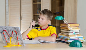 Funny Boy With Glasses Doing Homework. Child With Learning Difficulties. Boy Having Problems With His Homework. Education Concept. Stock Images
