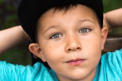 Funny boy with green eyes in a cap Stock Photo