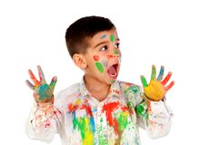 Funny boy with hands and face full of paint Stock Photo