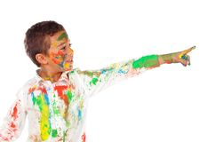 Funny boy with hands and face full of paint. Isolated on a white background royalty free stock photography