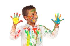 Funny boy with hands and face full of paint. Isolated on a white background stock photography