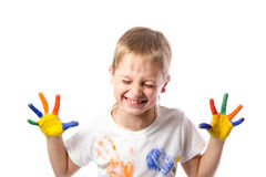 Funny boy with hands painted in colorful paint Royalty Free Stock Images