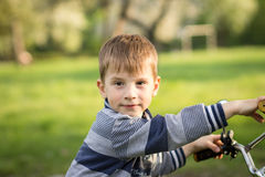 Funny boy has fun in summer park Royalty Free Stock Images