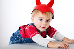 A funny boy in a hat with horns Stock Photography