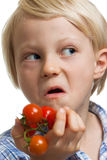Funny boy holding bunch of tomatoes Royalty Free Stock Photography