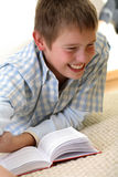 Funny Boy learning on the floor Stock Image