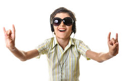 Funny boy listening music dancing Stock Photos