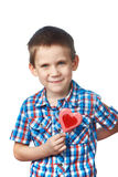 Funny boy with lollipop hearts Stock Image