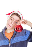 Funny boy looking at a red christmas ball Stock Images