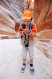 Funny boy looking in stone in Petra Royalty Free Stock Photography