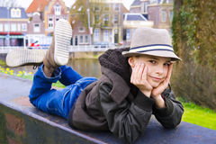Funny boy lying on the parapet at the park Royalty Free Stock Photography