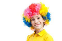 Funny boy in multi-coloured wig Stock Photo