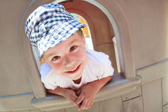 Funny boy on playground Royalty Free Stock Photo