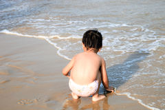Funny boy playing on the beach Royalty Free Stock Photo