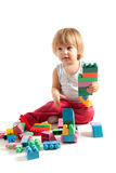 Funny boy playing with blocks Stock Photography