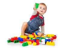 A funny boy is playing with lego Stock Photos