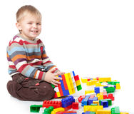 A funny boy is playing with lego Royalty Free Stock Image