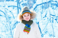 Funny boy playing outside on a sunny winter day Stock Photography