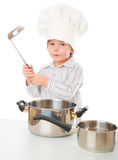 A funny boy is portraying a cook Royalty Free Stock Images