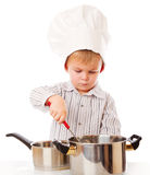 A funny boy is portraying a cook Stock Images