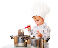 A funny boy is portraying a cook Stock Photo