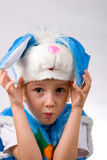 Funny boy in a rabbit costume. On a white background Stock Photos