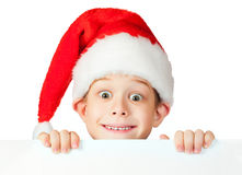 Funny boy in a rad Santa hat Royalty Free Stock Image