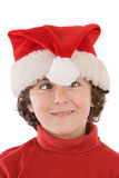 Funny boy with red hat of Christmas. On a over white background Royalty Free Stock Image